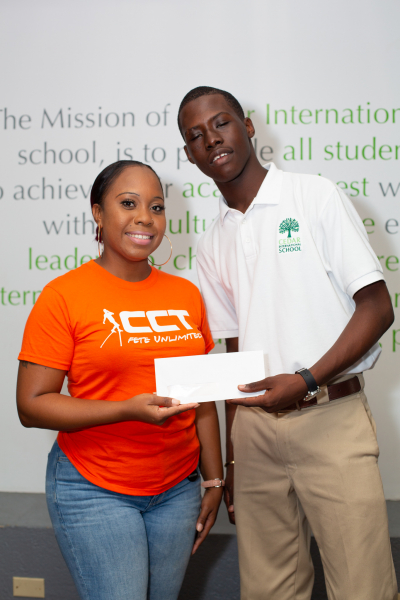 CCT presents donation to Mr. Jaleel Cameron, a student of Cedar International School on Tortola who will participate in the school's University Tour which is a part of their Experiential Education Programme. (Photo Credit CCT)