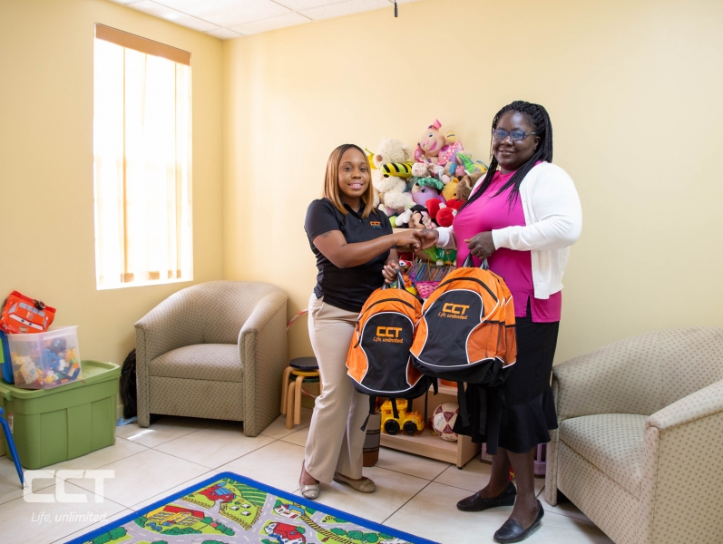 Rainbow Children's Home, Deputy Superintendent Ms. Eileen Potter receives backpacks and school supplies from CCT on Monday, August 20, for the children at the Rainbow Children's Home.