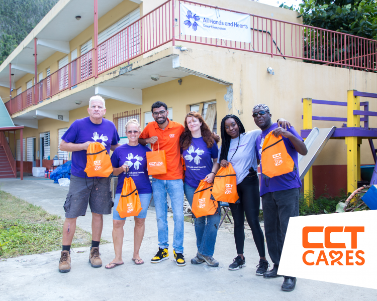 CCT's Multimedia Artist Christopher Kissoon presents gift bags and LTE Modem to All Hands and Hearts - Smart Response organization on Tuesday, February 27 at the Ivan Dawson Primary School. (Photo Credit CCT)