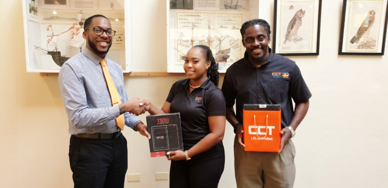CCT's Marketing Manager Recaldo Richardson and CCT's Public Relations and Marketing Coordinator Jerilee T. Hopkins presents ten Logic T10B Tablets on behalf of CCT to HLSCC's Vice President Dr. Richard Georges for the college's new digital learning platform initiative.