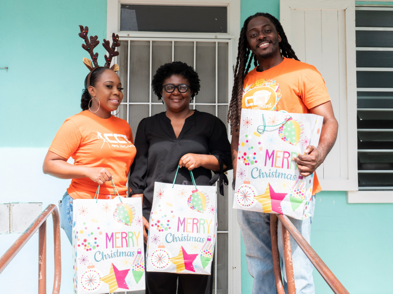 Social Development Department's Head of Family Children and Protective Services Division, Ms. Laurel Freeman accepts Christmas gifts and mattresses to the residents of the Rainbow Children's Home on Friday, December 13, 2019 from CCT. (Photo Credit CCT)