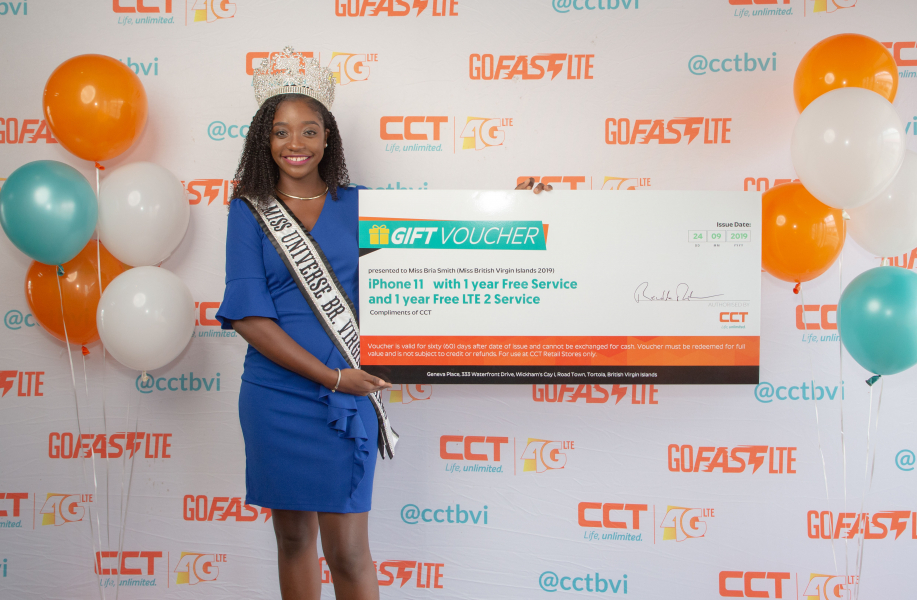 Miss BVI Bria Smith receives an IPhone 11, one-year phone service and one-year LTE 2 service, as part of her winnings from being crowned Miss British Virgin Islands 2019 compliments of CCT BVI on Friday, October 11, 2019. (Photo credit: CCT)