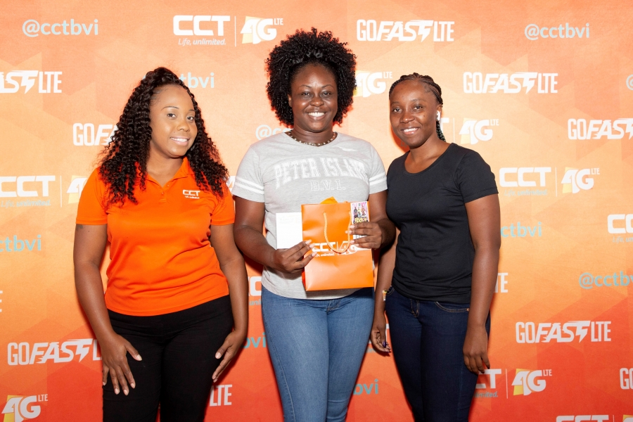CCT's promotion 'Win a free ticket trip to St. Kitts' winner Ms. Tahirah Warner alongside CCT's Public Relations and Marketing Coordinator, Jerilee T. Hopkins and Ultra Promotions owner, Ms. Akiema D. Brookes